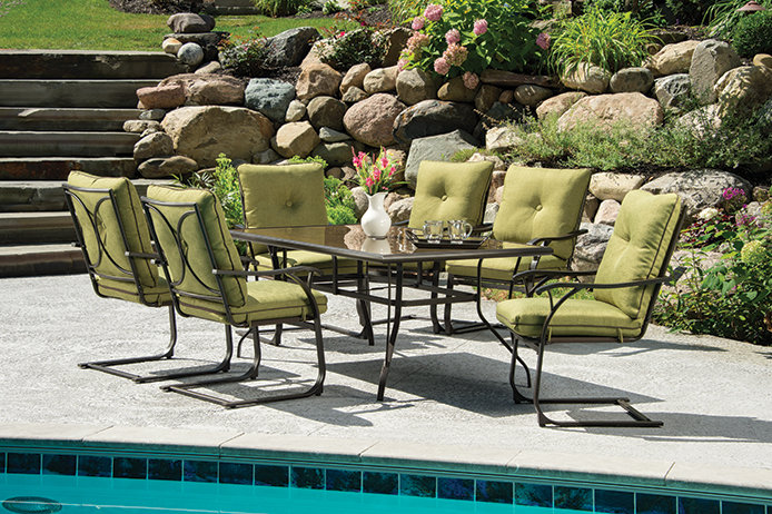 Green patio set by pool